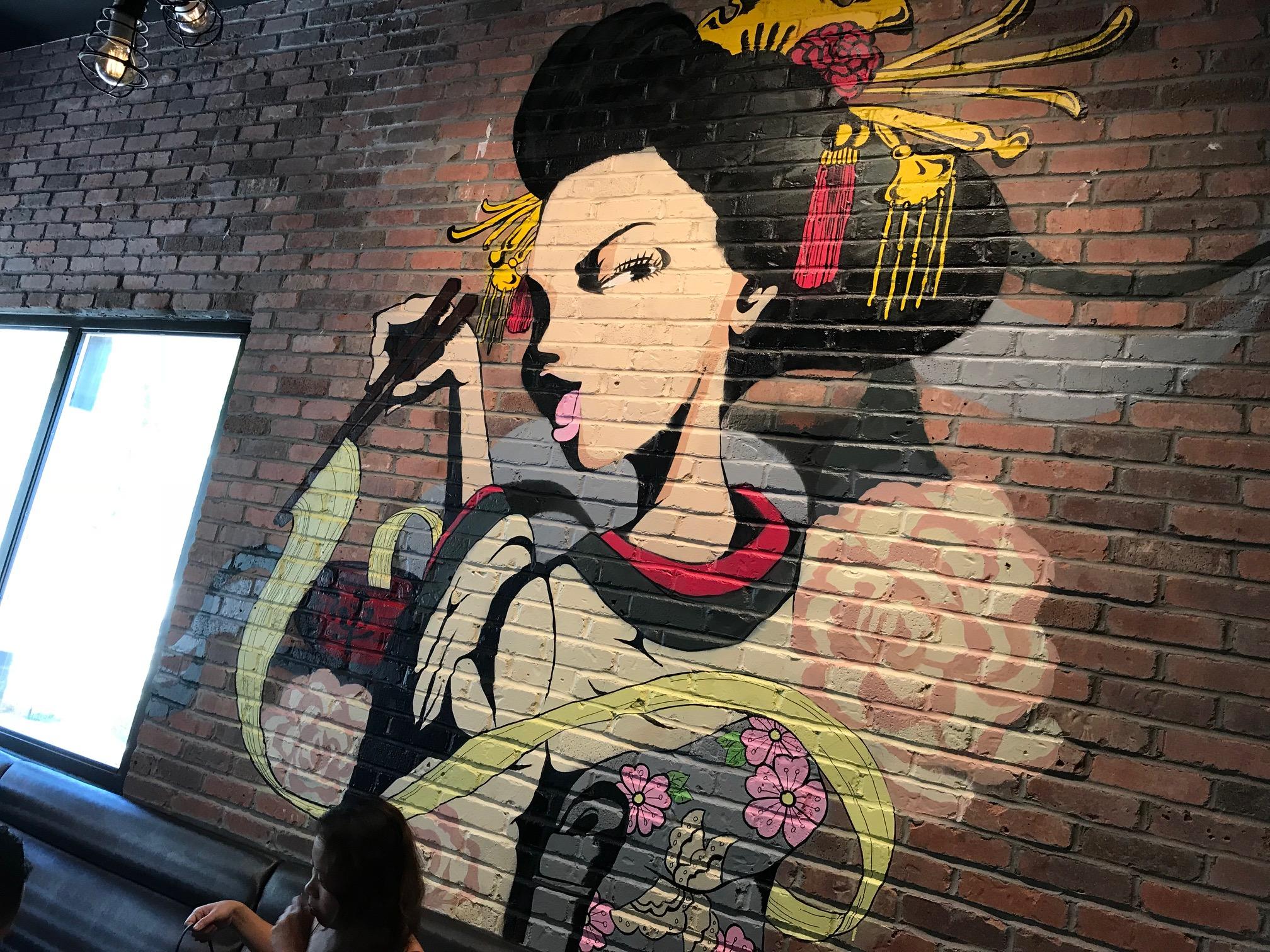 A colorful Asian mural greets patrons at Logan Circle's Jinya Ramen Bar  second level